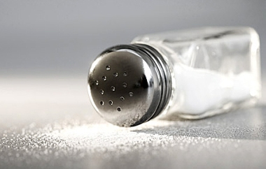 Tipped-over Salt Shaker --- Image by © Tom Grill/Corbis